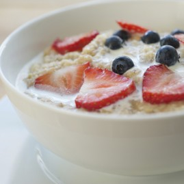 Oatmeal, strawberries, blueberries and cream.