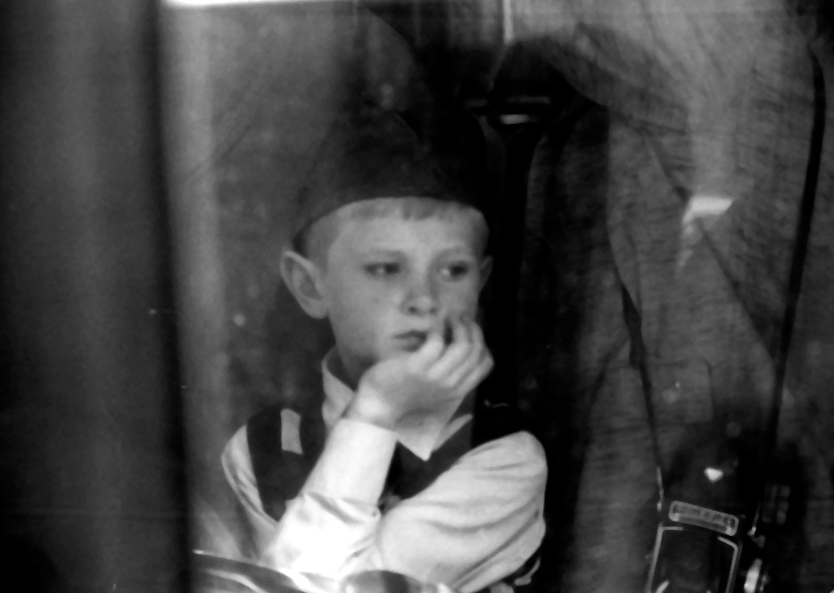 Boy on an bus in Moscow stares out the window.