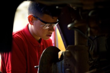 Ken Santos working on rear rotors and brake pads.